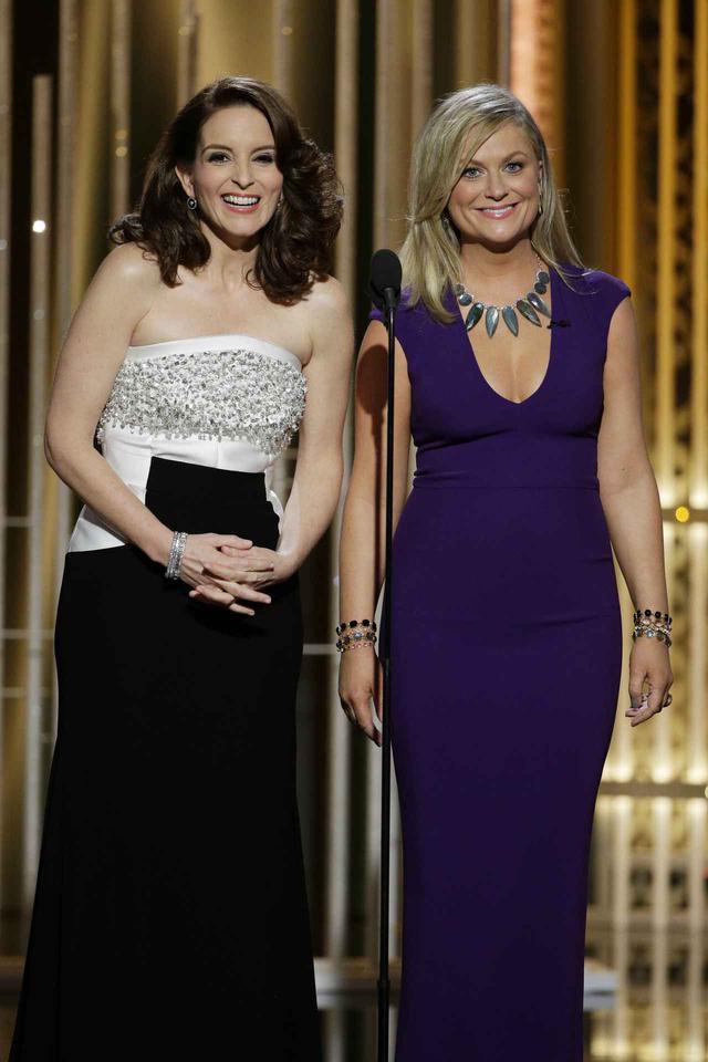 画像: 2015年にゴールデン・グローブ賞の司会を務めたティナ・フェイとエイミー・ポーラー。