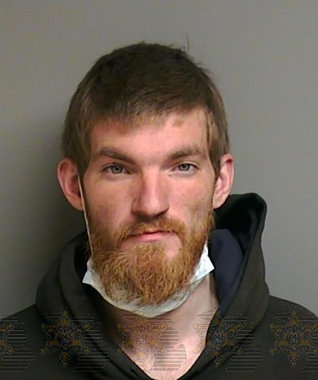 画像: 警察が公開したヒューズ容疑者の逮捕写真。