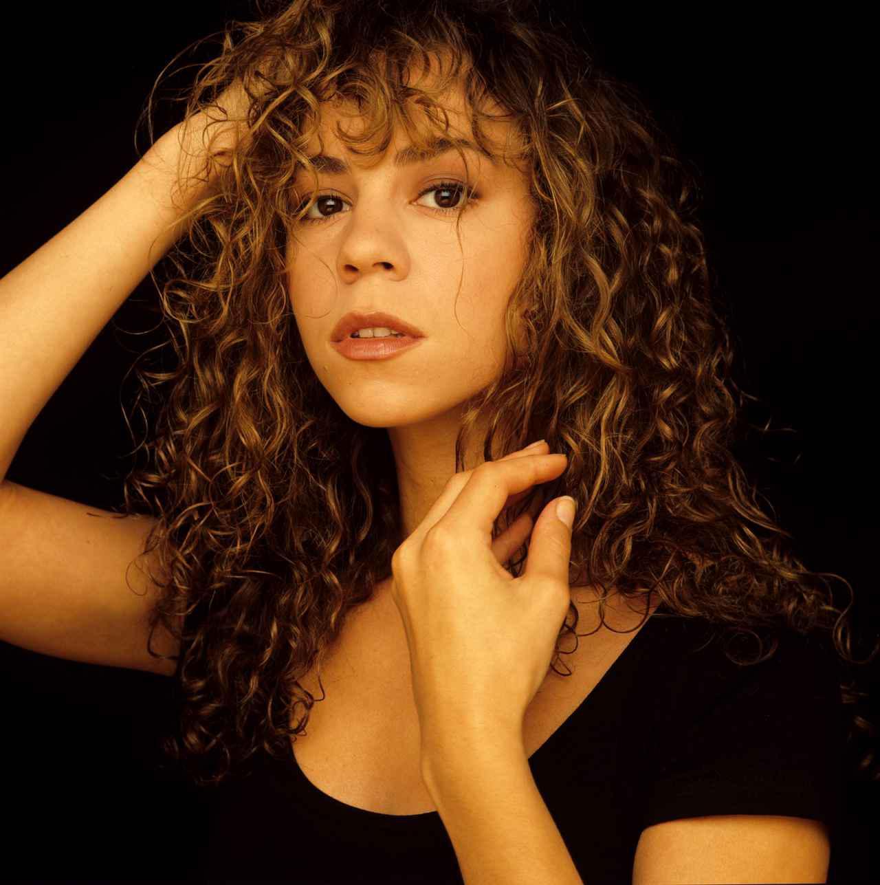 画像: 1990年、20歳頃のマライア・キャリー。