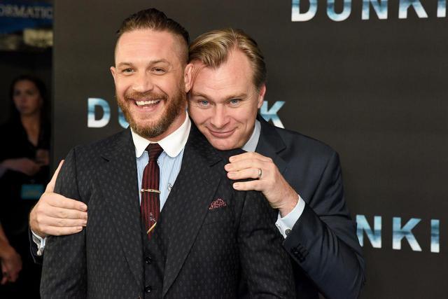画像: ベイン役のトム・ハーディとクリストファー・ノーラン監督。