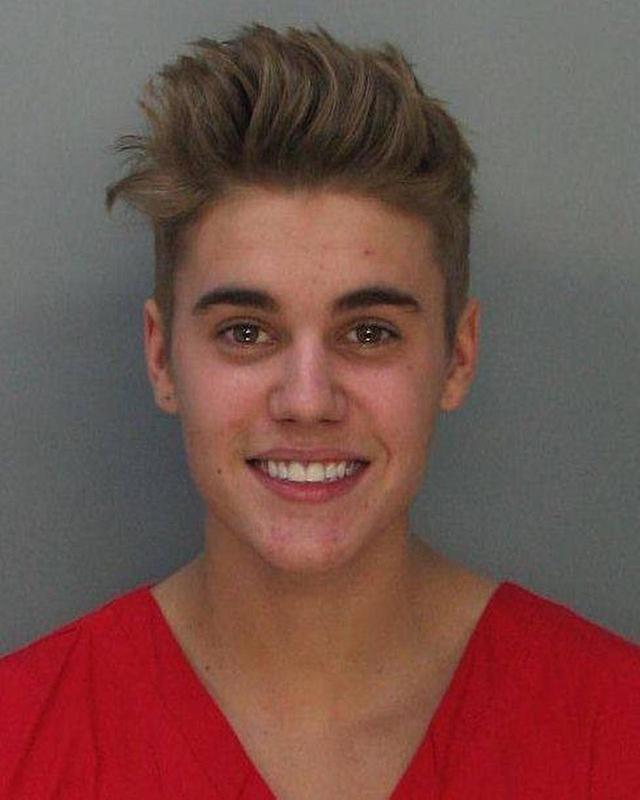 画像: 2014年に捕まった時の逮捕写真。