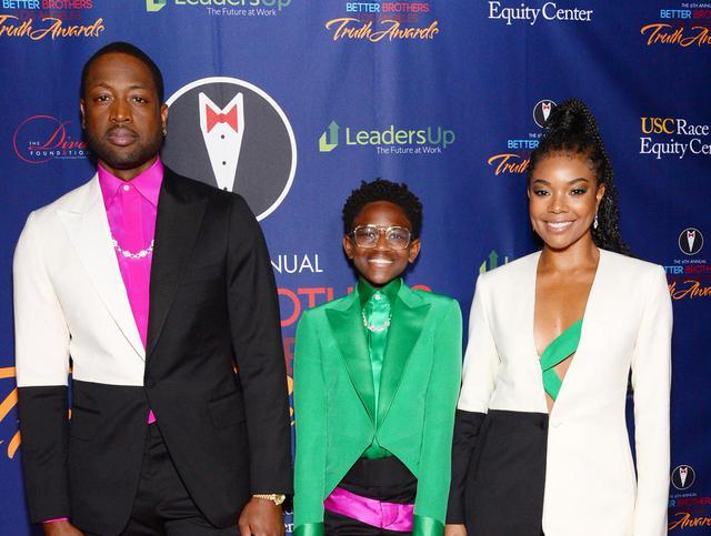 画像: ドラマ『LA's FINEST/ロサンゼルス捜査官』などで知られるガブリエル・ユニオン(右)。元NBA選手の夫ドウェイン・ウェイド(左)の娘ザヤ(中央)はトランスジェンダー。