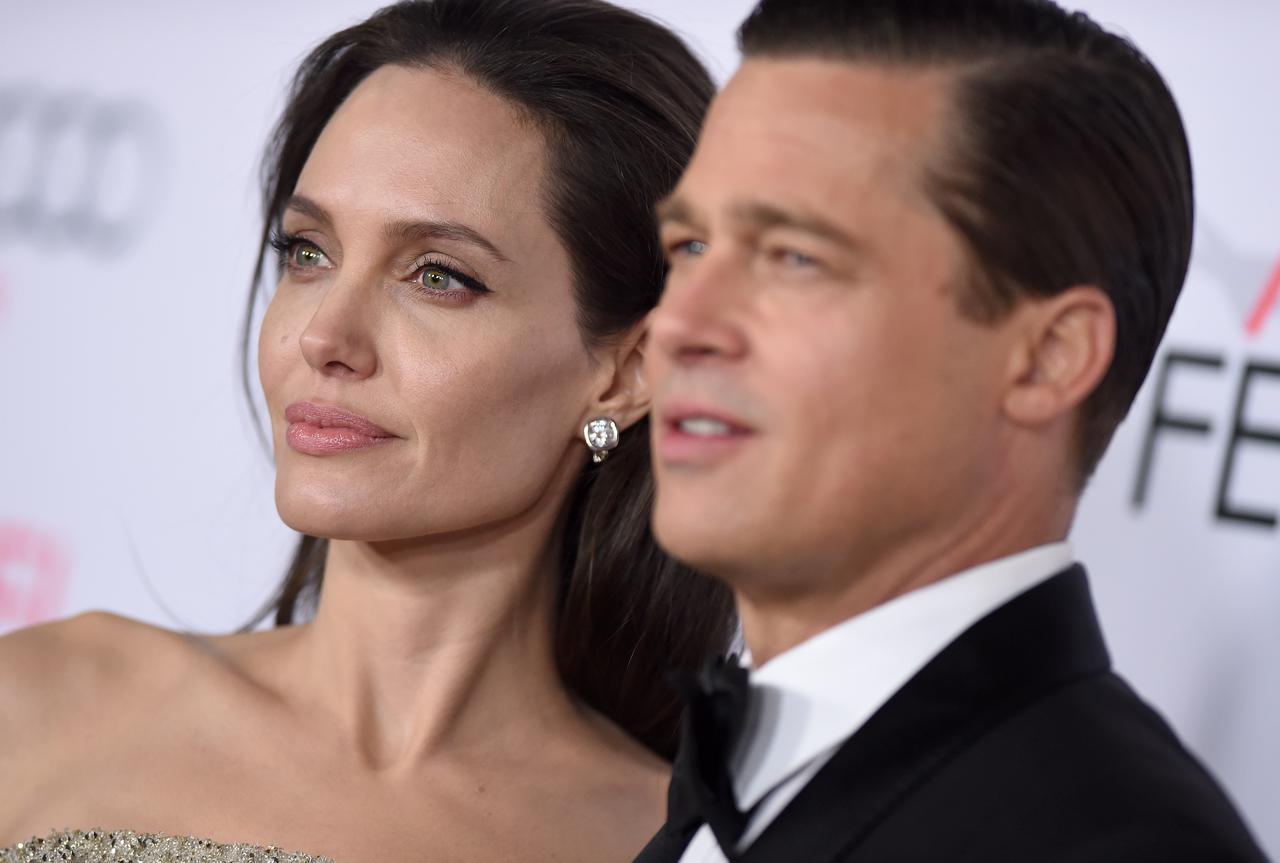 画像: アンジェリーナ・ジョリー(左)と別れた夫のブラッド・ピット(右)。