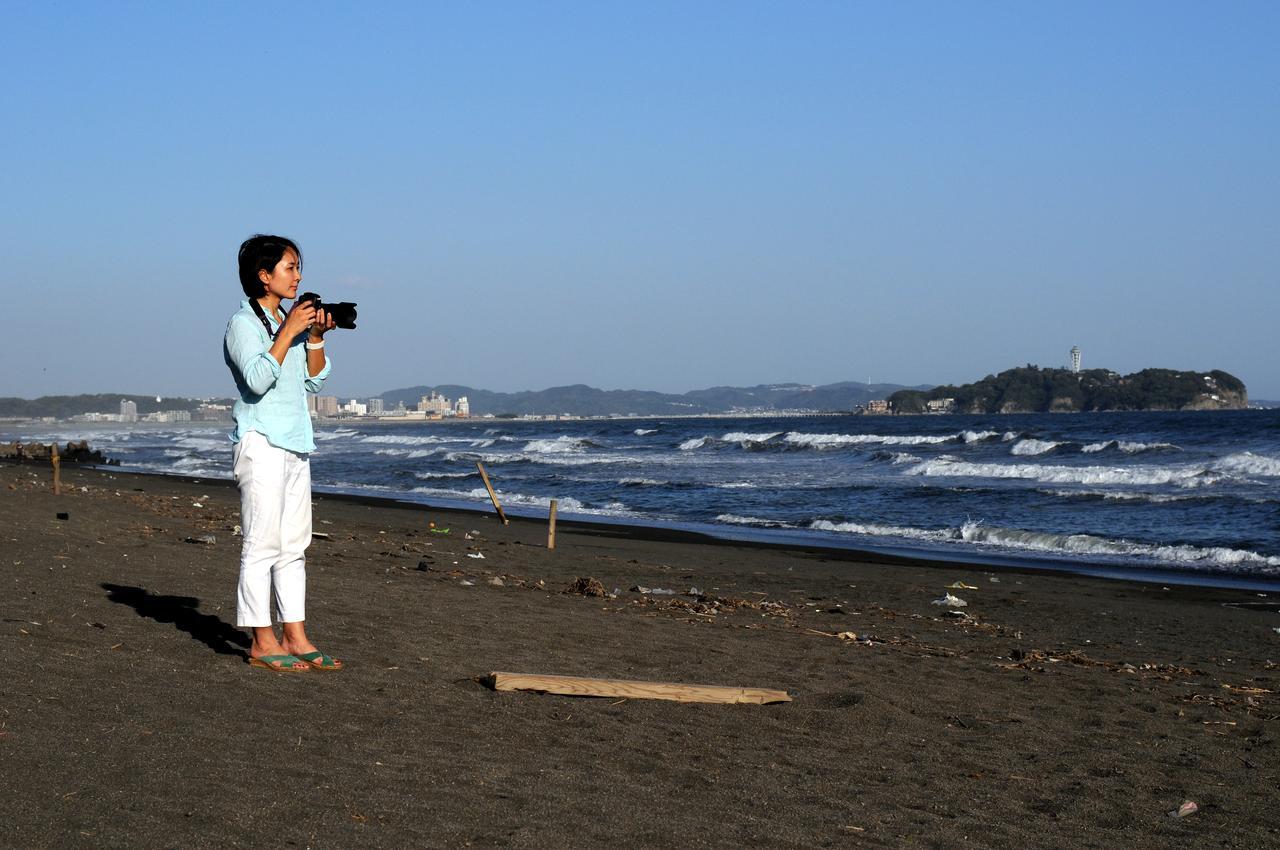 画像: ほぼ毎日、地元の海岸を散策し撮影をする大門さん。