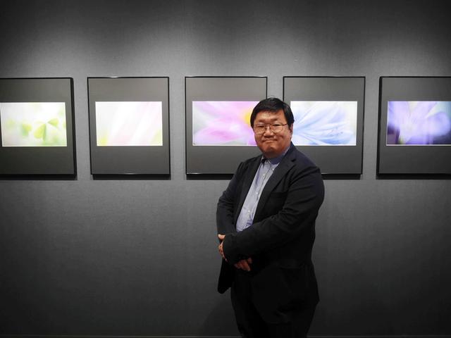 画像: 実質的な同展の主宰者、山田久美夫さん。