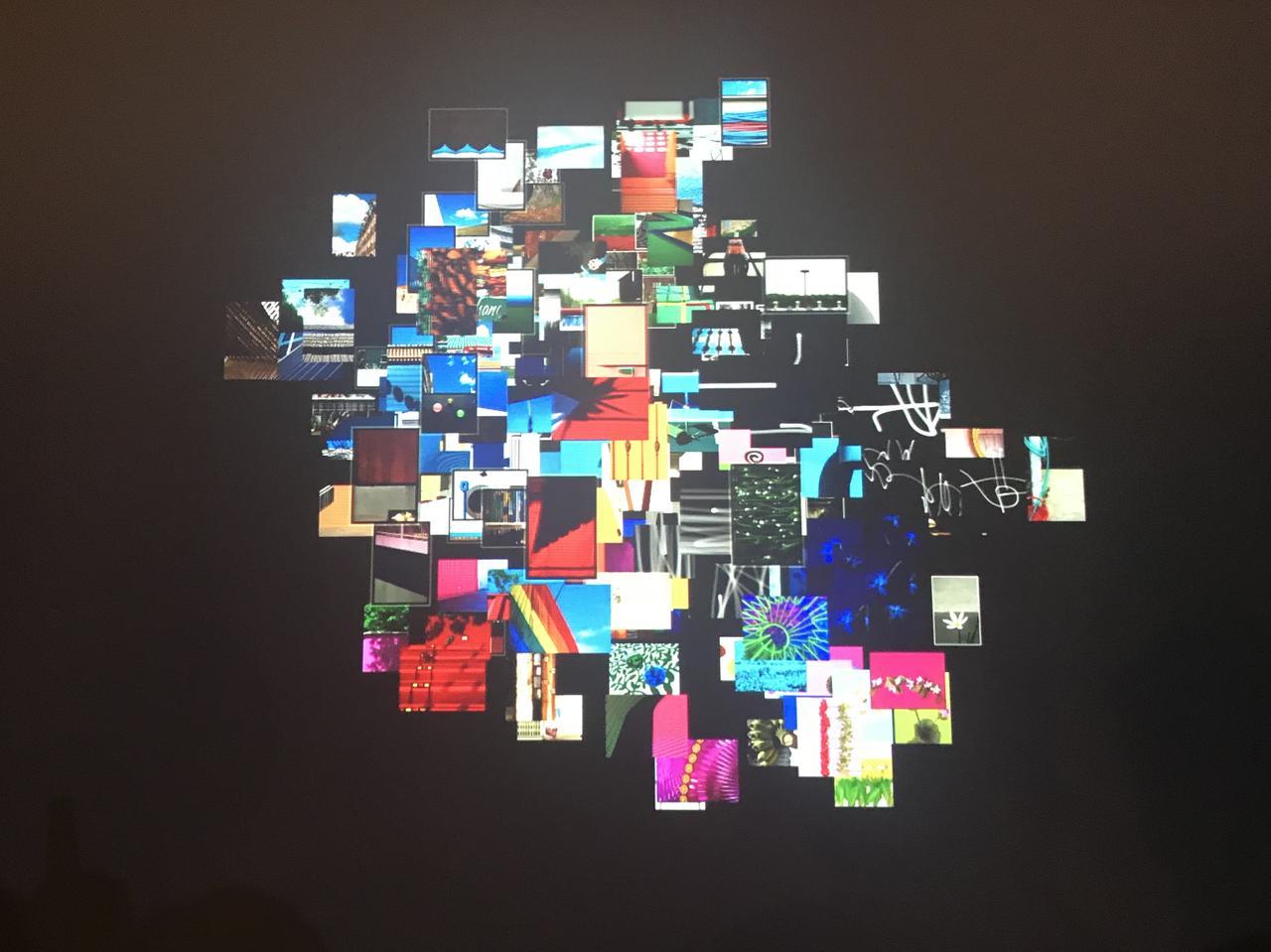 画像: ▲写真展会場ではプリントだけでなく、映像による展示も行われていた。