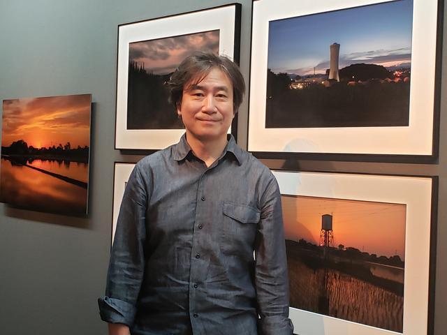 画像: 写真家、比留間幹さん。穏やかな優しい佇まいと静かな口調で給水塔のお話を聞かせてくださいました。