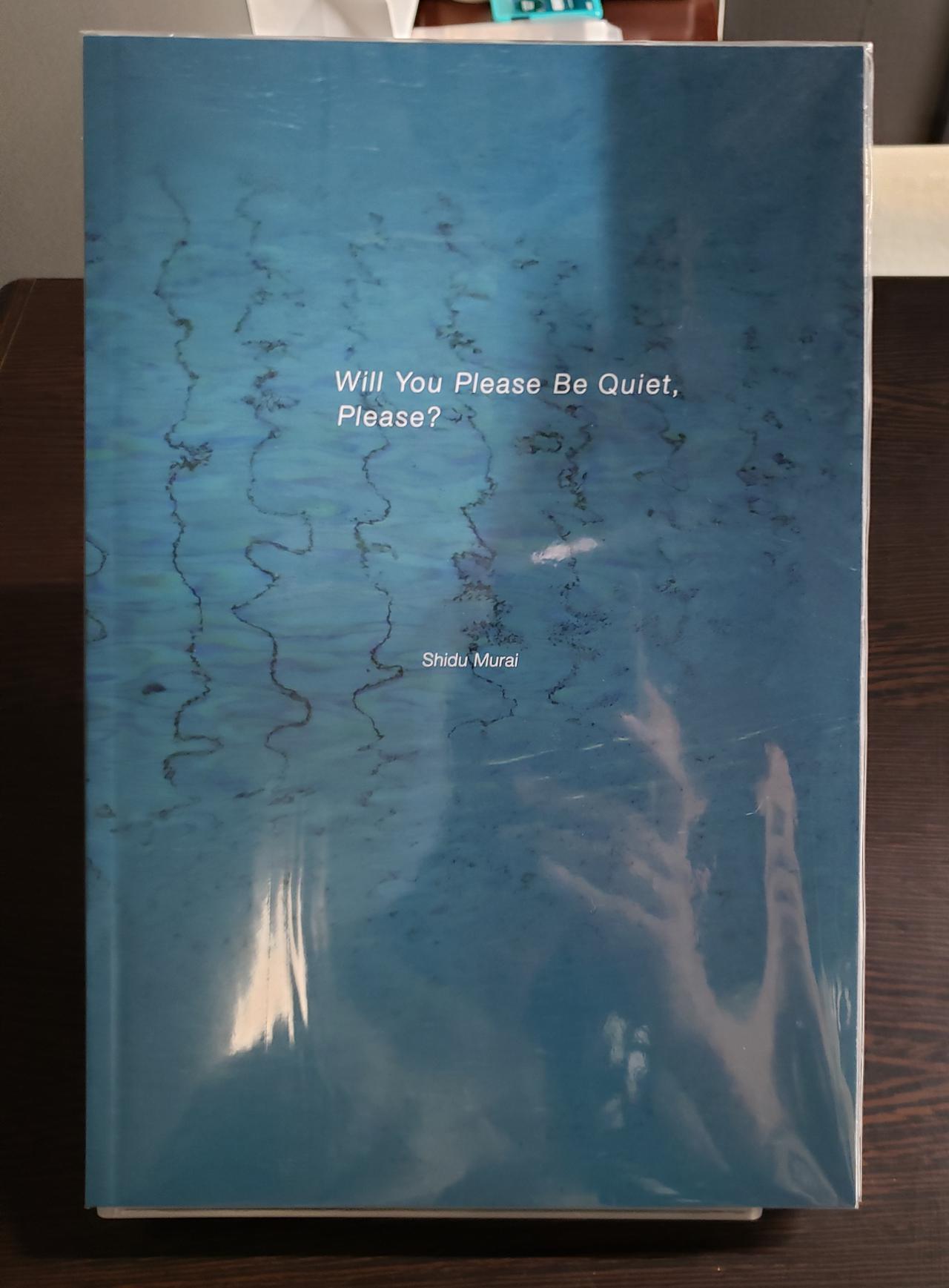 画像: 会場では、村井さんが2018年に上梓した写真集「Will You Please Be Quiet, Please?」(30部限定/B5変形判/ソフトカバー/64ページ)も販売中です。