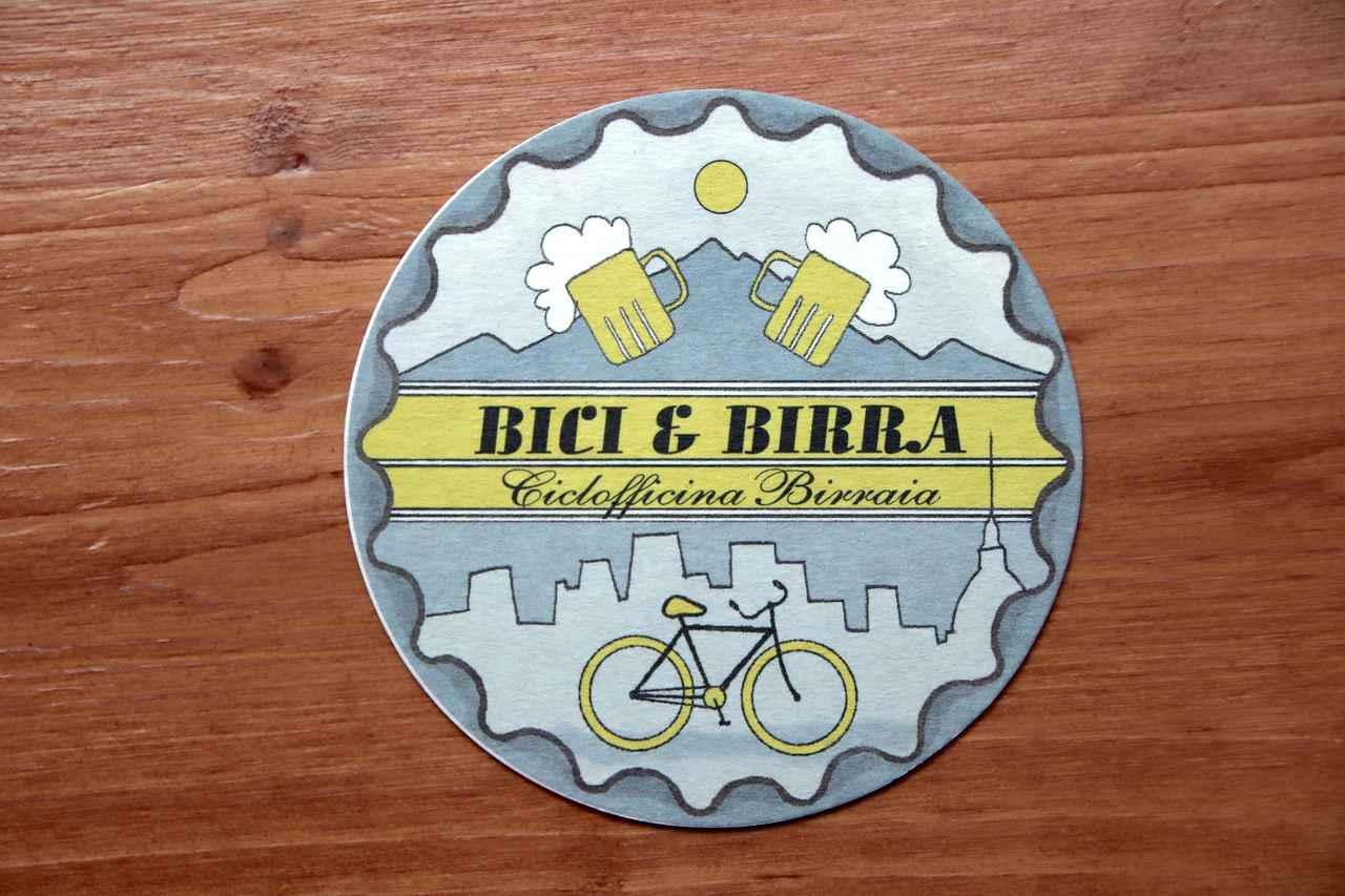 画像: コースター。Bici e Birraとは、「自転車とビール」の意味。自転車工房とビール店との説明書きも。