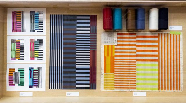 画像: 『須藤玲子の仕事-NUNOのテキスタイルができるまで』の展示風景から。図案や指示書、製品サンプルなども並ぶ © CHAT, HONG KONG