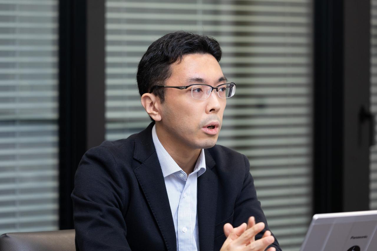 画像: 塩川 祐介氏 野村総合研究所 DX生産革新推進部 bit Labsグループ 上級システムコンサルタント