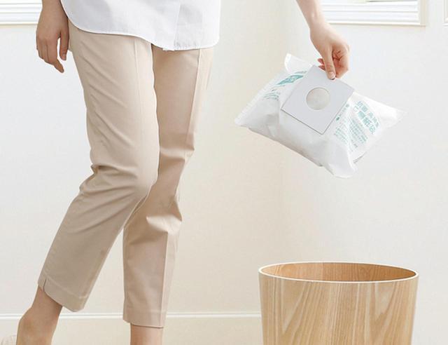 画像: 5層構造の高捕集紙パックを採用。ホコリが舞い上がらず、清潔・簡単なゴミ捨てが可能。