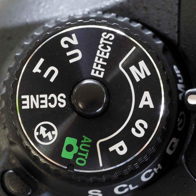 画像: モードダイヤルに書かれた四つの露出モード(P・S・A・M=写真はニコン・D7200)。写真上達のためには、この4モードを上手に使い分けたい。