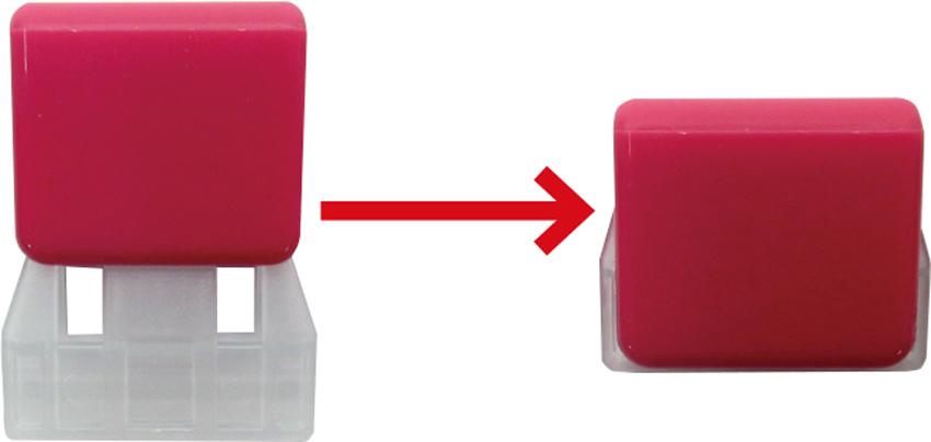 画像: 柔らかいスライダー(白い部分)で紙を挟んだあと、色つきのカバーを下ろして固定する。