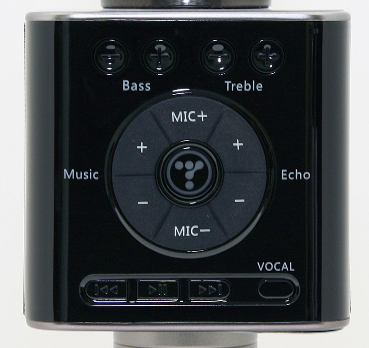 画像: 操作部の中央のマーク(円形)が電源ボタン。その上下がマイク音量、左が音楽音量、右がエコー調整の各ボタン。右下の「VOCAL」ボタンを押すと、ボーカルがキャンセルされる。