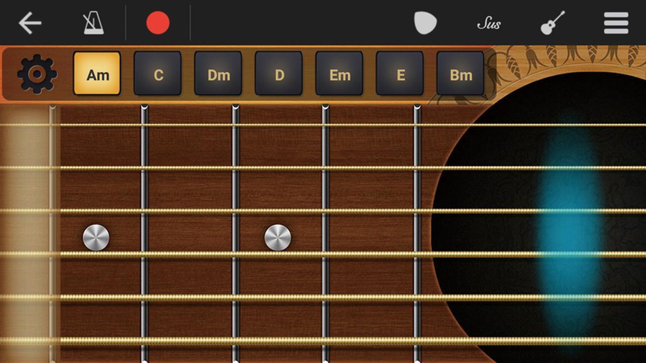 画像: ギターのシミュレーター画面。上に並ぶコードをタップして選び、弦をタップするとコードが鳴る。サンプル曲を再生することもできる。