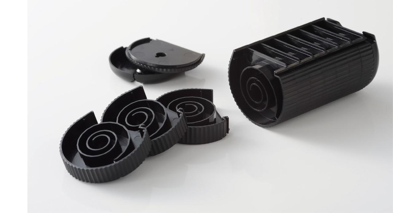 画像: ハーモニカの各吹き出し口に対応した独自の消音構造で、音を封じ込めるサイレンサー。