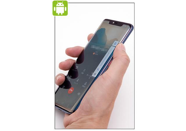 画像: 相手の声の調節は、通話中に側面の音量ボタンを押すことで行う。親指または人指し指で「+」あるいは「-」のボタンを押せばいい。