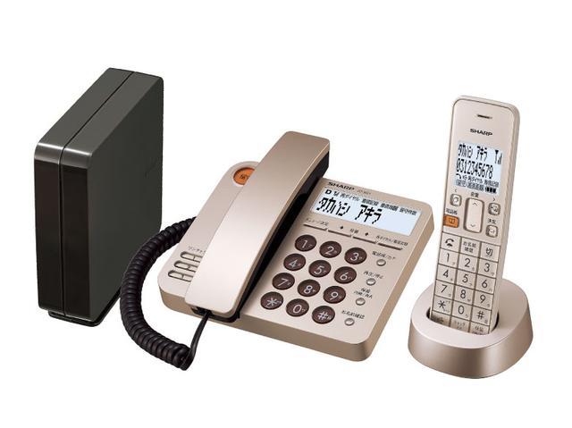 画像: 製品の構成は、電話機本体と子機、電話線接続ボックスの3点。カラーは写真のシャンパンゴールドのほか、ブラウンメタリックを用意。