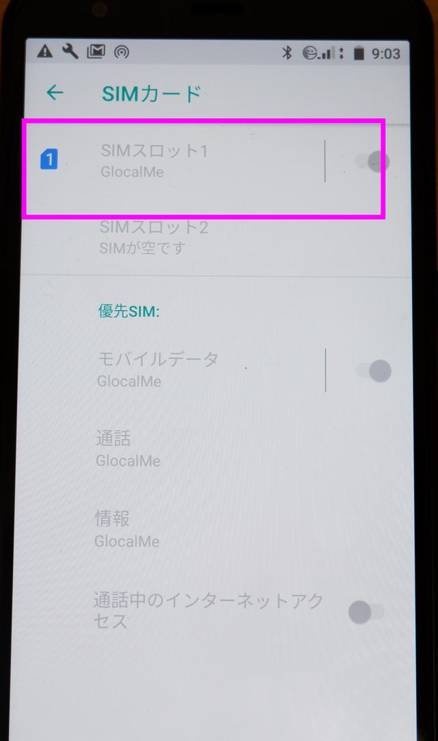 画像: SIMスロットには、GlovalMe用のカードが入っている