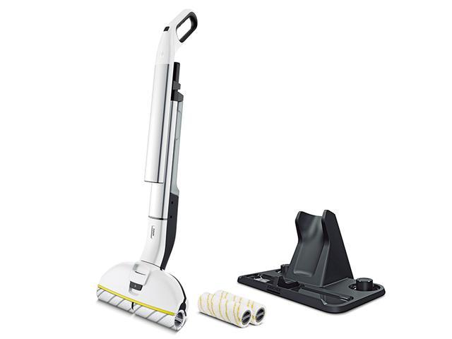 画像: コードレススティッククリーナーのようなスタイルで、簡便に床の水拭きが可能な新ジャンルの掃除機。付属の専用スタンドで、ローラーと一緒に、本体を立てた状態でスッキリと収納できる。サイズは幅305ミリ×高さ1170ミリ×奥行き226ミリ。重量は2.5キロ。