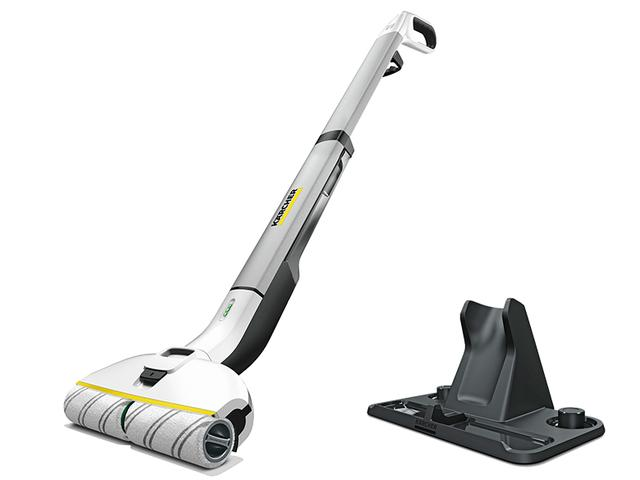 画像: 立ったまま水拭き掃除ができるコードレスのフロアクリーナー。掃除機では取り除けない飛沫や皮脂汚れを拭き取る。本体とローラーが収納できるスタンド付き。