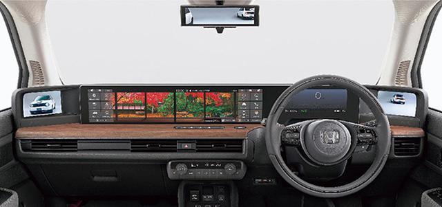 画像: インパネ左右いっぱいにレイアウトされる五つのスクリーンが斬新。ナビやテレビなどさまざまなアプリを用意。ウッドとファブリックのコーディネートで品質、質感にもこだわる。