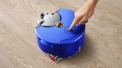 画像: シンプルなワンタッチ・コントロール。アイコンがロボット掃除機の状態を表示するとともに、バッテリー残量、詰まり、Wi-Fi接続など、さまざまな情報を伝えます。 www.dyson.co.jp