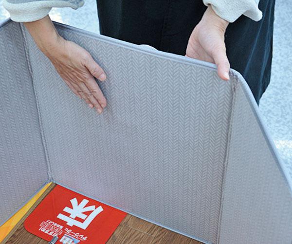 画像: 遠赤外線を放射するので、換気をしてもポカポカ状態をキープ。足元や背中を囲うようにして使う。