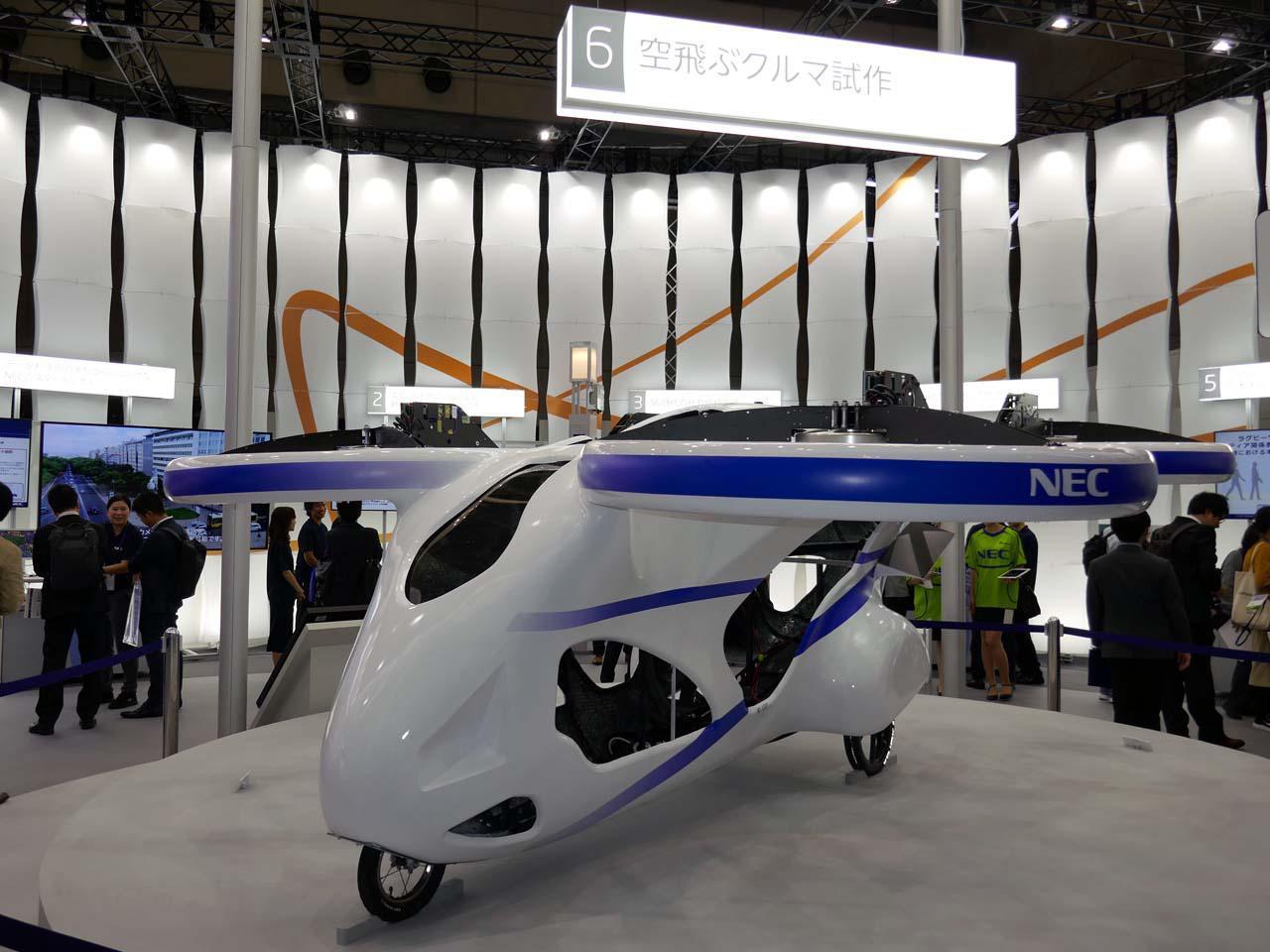 画像: NECが考える空飛ぶクルマの試作機。無人ではあるものの、2019年8月に飛行試験をテストフィールドで成功させた