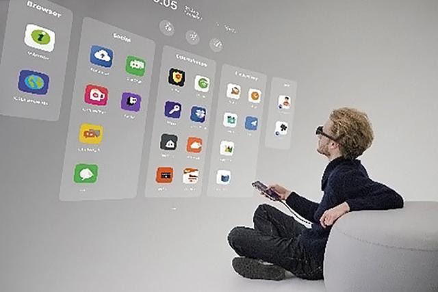 画像: KDDIは、5Gスマホと連係して大画面が楽しめるスマートグラスを発売。