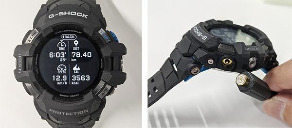 画像: 写真右は、専用充電ケーブルで充電しようとしているところ。受電ケーブルと本体は磁石で接続するようになっている。