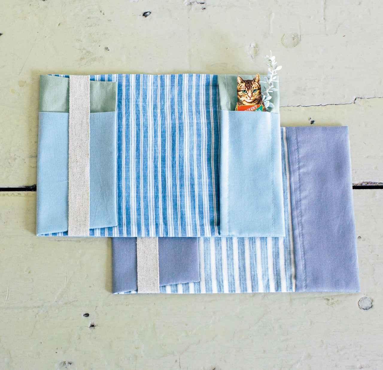 画像: 左側の折り返しをスライドさせれば、さまざまな厚さの本に対応。内側や、袋ポケットの布は薄いものを使って