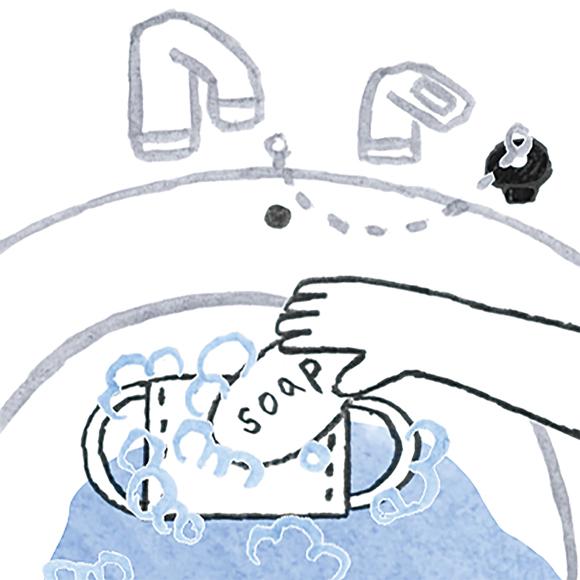 画像: 2 両面に固形石けんを塗って押し洗いする