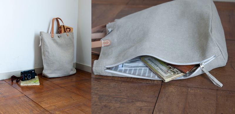 画像: B4サイズが納まる縦型。バッグの下に潜り込んだものも取り出しやすいよう、片脇にファスナーあきを。リネンキャンバスになじむ、革の持ち手で大人っぽく。裏地はちらりと見えてもおしゃれなボーダー柄を選び、ファスナーあきの内ポケットも共布で。