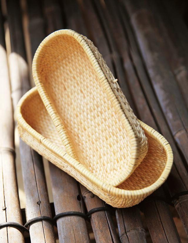 画像: 細い柳で編み上げる飯行李。通気性が高く、余計な水分を吸ってくれるため、ごはんをおいしくしてくれる。1万5000円~