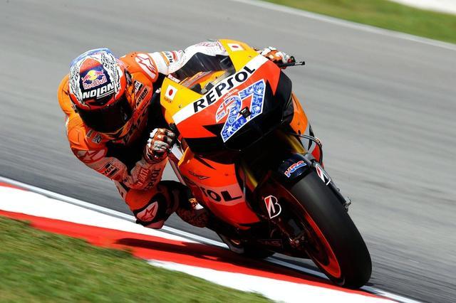 画像: 2011年、マレーシアGPでのC.ストーナーの走り。 www.redbull.com
