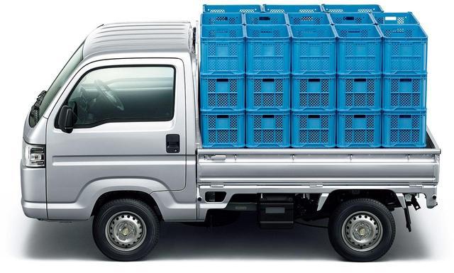 画像: 広々と余裕のある荷台には、みかんコンテナが52個積める! www.honda.co.jp