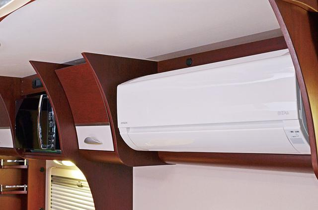 画像: エボライト充電システムなら、家庭用エアコンも安心して利用できる。