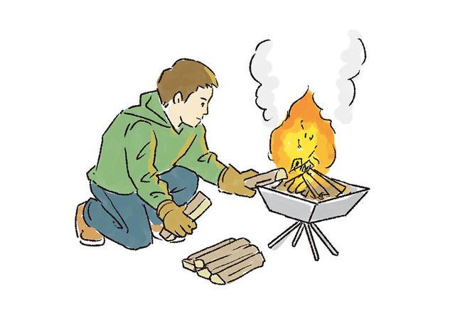 画像: 4  炎が安定したら、太い薪をくべる