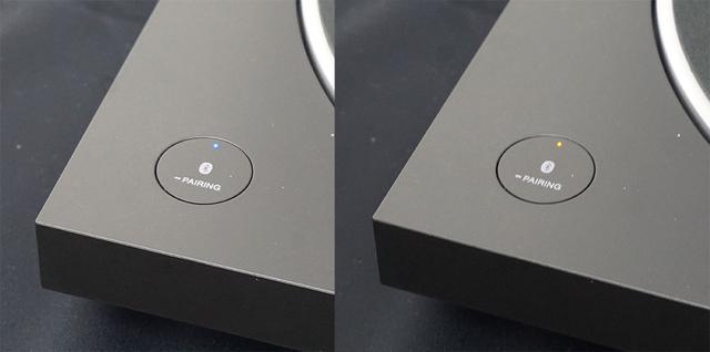 画像: Bluetoothのペアリングは写真のボタンを長押しして行なう。左の青いLEDが接続状態で、右はペアリングができていない状態を表す。ペアリングしておくと、本体でレコードを再生したら自動的にBluetooth接続機器を起動する