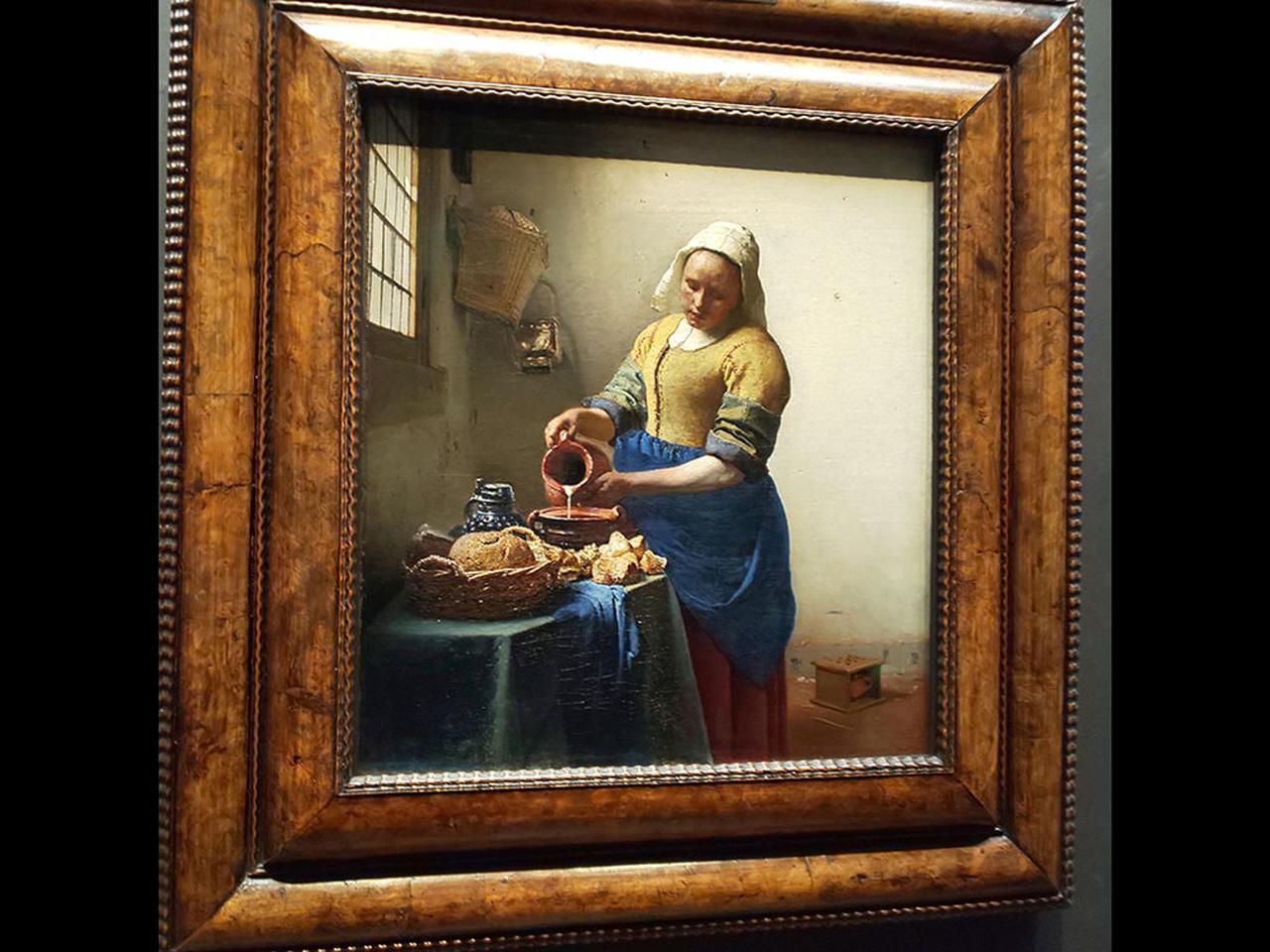 画像: フェルメールの『牛乳を注ぐ女』