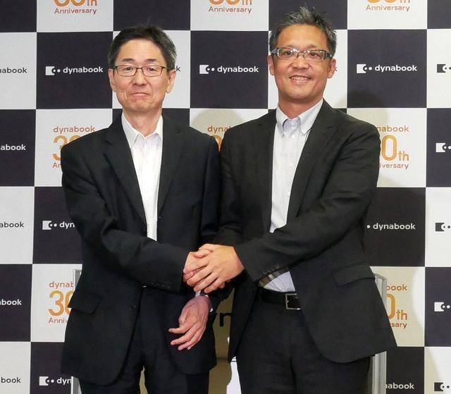 画像: ▲覚道社長(左)と日本マイクロソフトの執行役員 梅田成二氏(右)