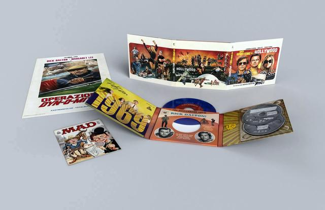 "画像: COLLECTORS EDITION ●Premium, collectible packaging ●Exclusive NEW MAD Magazine parody of the Rick Dalton TV series ""Bounty Law,"" Lousy Law ●45 vinyl record with 2 songs from the film's soundtrack & turntable adapter ●Collectible, vintage poster"