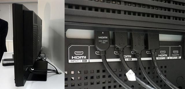 画像: パネル部の厚みは約99mmで、業務用モニターとしては標準的なサイズだ。写真右が接続端子部で、8K入力と4K入力をそれぞれ2系統備えている