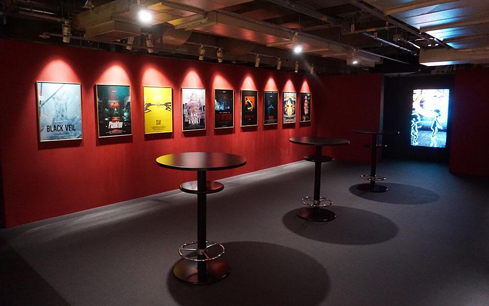 画像: 「THE MILLENIUM PARADE THEATER」のエントランスには、彼らが手がけるポスターアートが並ぶ。初公開の2枚もファンは必見
