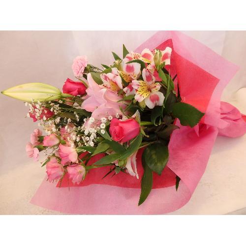 画像: ピンクのユリの花束(フィオリスタ ぴあに)