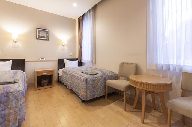 画像: 穏やかなトーンでまとめられたベッドルーム