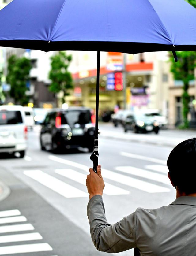 画像: 雨の日が待ち遠しい 「グリップ矯正アンブレラ」