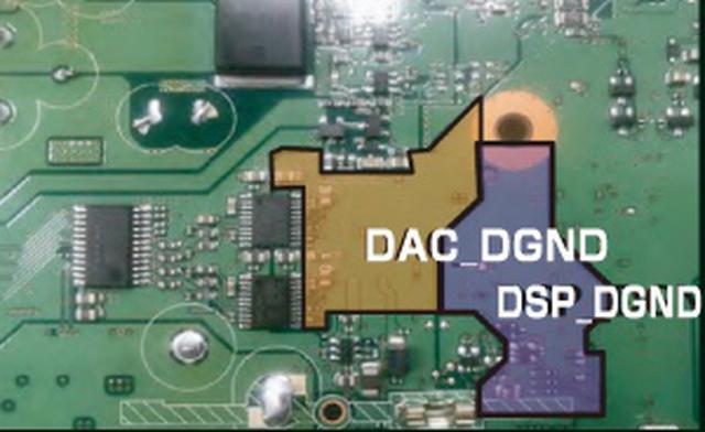 画像: オーディオ電源とディスプレイ電源を別構成とするためにアースパターンを独立させた「DSP/DAC専用アース」。さらに、このアースをシャーシグラウンドへおとすために、あらたなビス留め箇所を増設した。この構成のためにオーディオ用基板は新規設計となった。(画像提供:Panasonic)